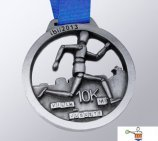The company TodoTrofeo designs and manufactures the medal for the competition 6mi Villa Del Juguete